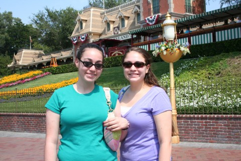 Emily and Kara at the entrance to Disneyland!