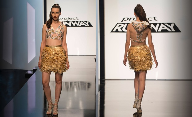 Kelly - This reads superhero costume to me (or perhaps something Sporty Spice would wear), but I enjoyed it anyway.  I love the pattern creation on the top.